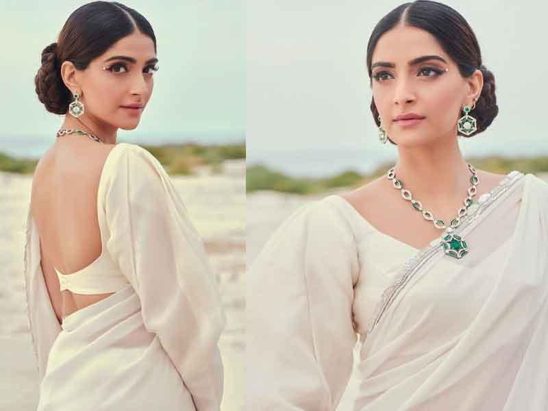 https://moviekoop.com/Images/News/Sonam-Kapoor-in-white-saree.jpg
